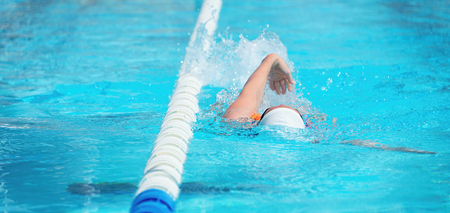 Female swimmer in an outdoor swimming pool,swimmer in blue pool water