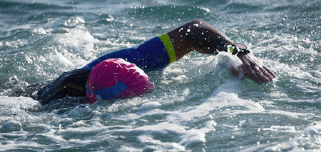 Man swimmer swimming crawl in blue sea,training for triathlon Stock Photo