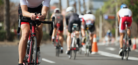 Cycling competition,cyclist athletes riding a race,racing bike during ironman competition