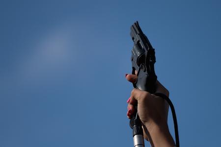 Starting pistol being fired hand firing a gun for starting race