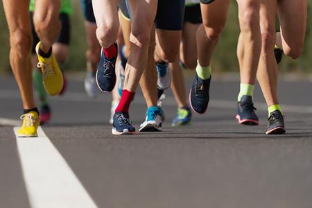 Marathon running race, people feet on city road Reklamní fotografie