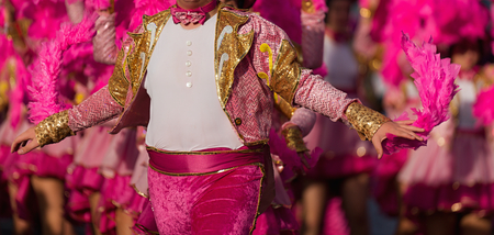 A man in costume dancing on carnival