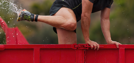 Runner in the container of ice water, race an extreme obstacle course