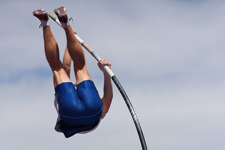 Athlete pole vault with a sky