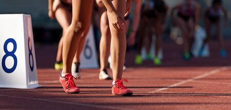 Sports women starting run sprint race on track and field competitions Stockfoto