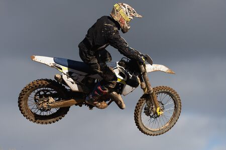 Motocross bike in a race representing concept high jump in the air Stok Fotoğraf