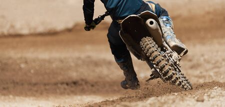 Motocross racer accelerating speed in track,driving in the motocross race