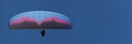 Paraglider tandem fly against the blue sky,tandem paragliding guided by a pilot Stok Fotoğraf
