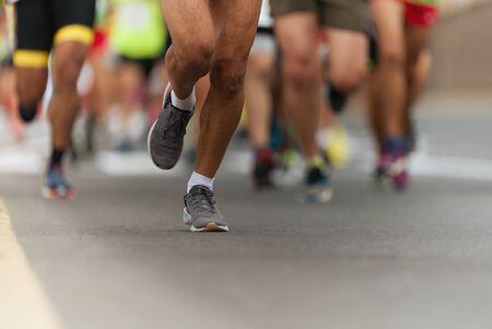 Marathon running race, people feet on city road Stock Photo