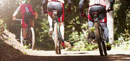 Group of athletes mountain biking on forest trail, mountain bike race Reklamní fotografie - 140459596