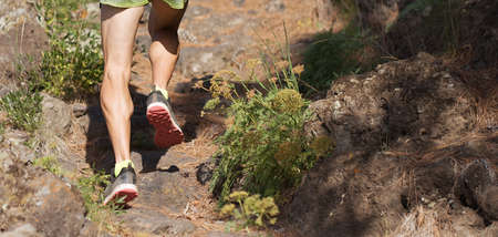 Trail running man on mountain path exercising Stock Photo
