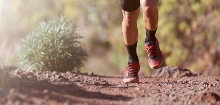 Trail running man on mountain path exercising Reklamní fotografie