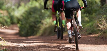 Mountain bikers riding on bike singletrack trail, mountain bike race Reklamní fotografie - 142637052