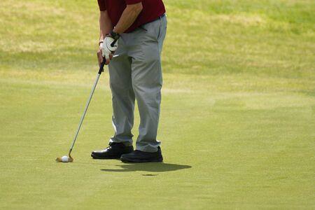 Playing golf preparing to shot,man putting on green