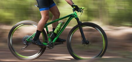 Bike panning shot in the forest, captured in summer