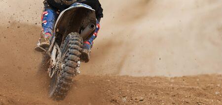 Motocross racer accelerating speed in track, driving in the motocross race Reklamní fotografie