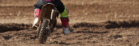 Racer child on motorcycle participates in motocross race, active extreme sport 写真素材