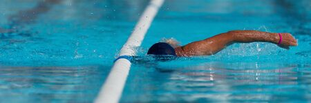 Swim competition swimmer athlete doing crawl stroke in swimming pool Reklamní fotografie - 145743208