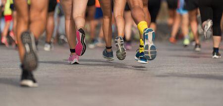 Marathon runners running on city road, large group of runners Reklamní fotografie