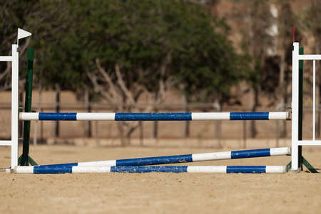 Wooden barriers for jumping horses, empty field for horse jumping event competition