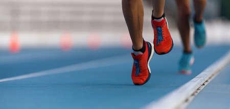 Athletes sprinters run speed on track of stadium