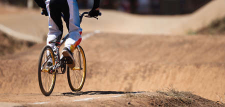 BMX rider competing in the child class on the off-road circuit Stock Photo