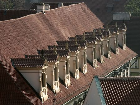 dormer: Old dormer on an old historical building in Old Town Prague Stock Photo