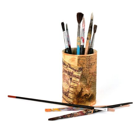 Assorted size and shape paintbrushes, in a metal can. photo