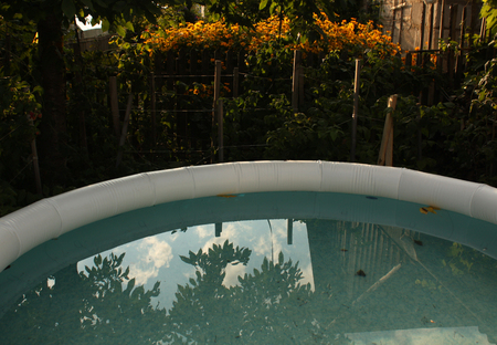 Inflatable swimming pool. Sunset in Garden. End of summer season Stock fotó