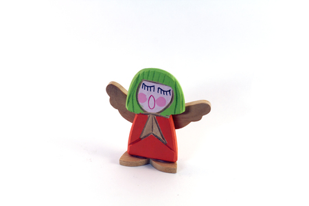 Wooden angel figure isolated on white. Collections and holidays.