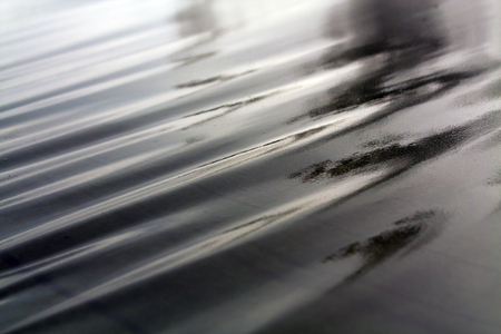 an awning: Dark green wet awning on wind. Blurs and abstract background. Stock Photo