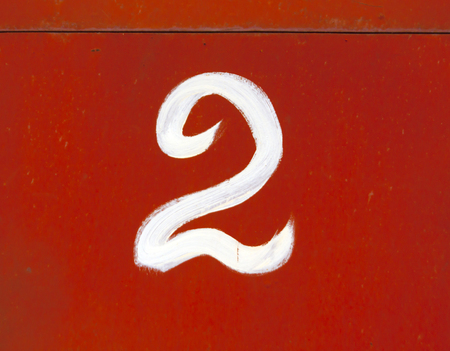 red metal: Number two on red metal wall. Numbers and figures.