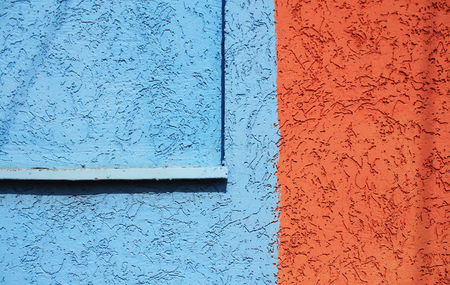redecorate: Blue and orangeplaster wall texture. Architectural background