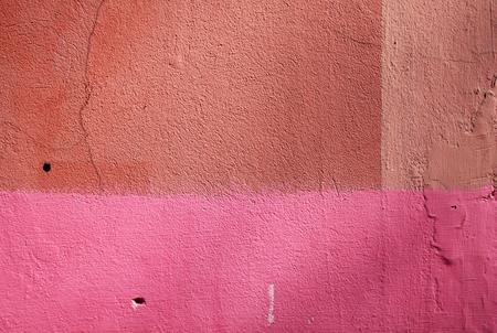 textured wall: Pink and orange grunge plaster wall texture. Architecturalbackground.