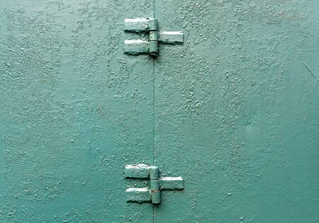 Green painted metal wall texture. Architectural background.