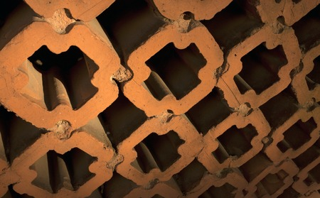 porous brick: Red pattern clay fence texture. Architectural background.
