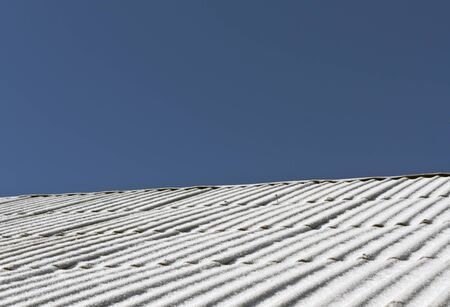 slate roof: Snow on slate roof texture. Architectural background.