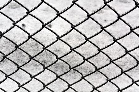rabitz: Wire fence and snow texture. Seasonal background Stock Photo