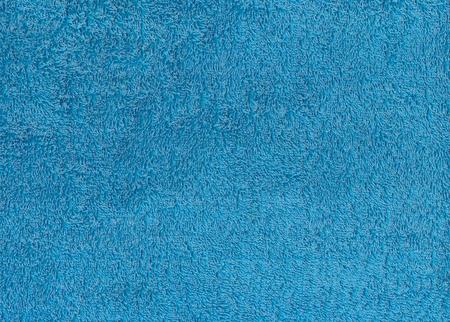 Blauwe textiel handdoek textuur. Achtergrond en textuur. Stockfoto