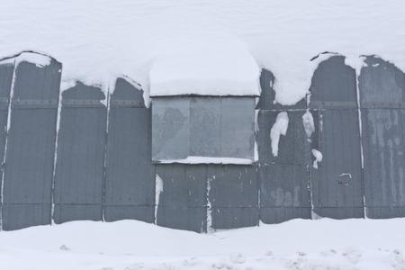 hangar: Metal hangar in snow. Architectural and seasonal background.