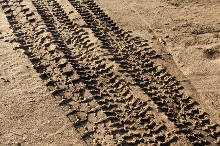 sand mold: Car tracks on dirty sand road. Background and texture. Stock Photo