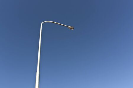 lamp post: Lamp post and blue sky. Power and electricity. Stock Photo