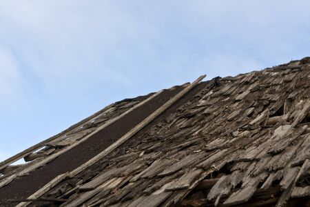 damaged roof: Damaged old house roof. Architectural background