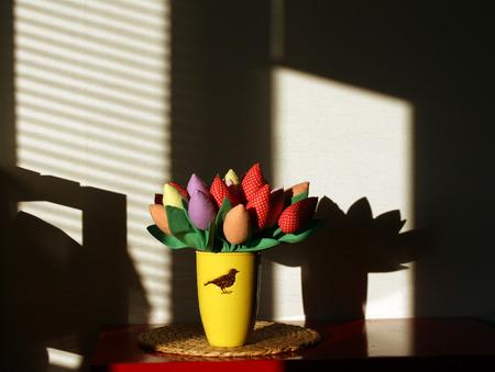 craftwork: Handmade colorful tulip flowers in vase. Craftwork Stock Photo