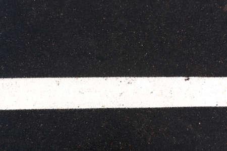 traffic regulation: White traffic line on asphalt road. Road and traffic Stock Photo