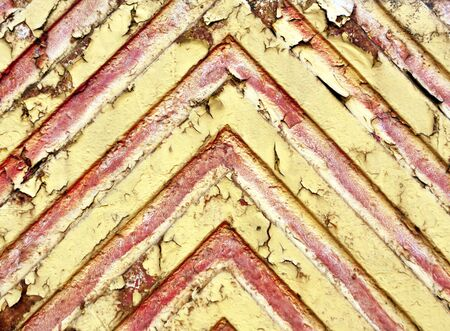 pitting: Red lines on yellow metal surface. Background and texture.