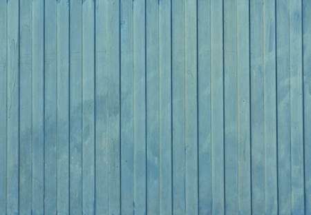 navy blue background: Navy blue painted metal fence texture. Architectural background and texture.