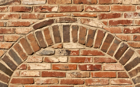 brick texture: Old red brick wall texture with arch. Architectural background