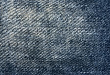 worn: Worn blue denim texture. Background and texture for design.