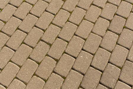 pedestrian walkway: Grey pedestrian walkway close-up. Background and texture.